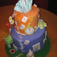 Alice In Wonderland Fron This cake was created for a little girls birthday party. So much detail is attached to this cake, from Alice falling down the rabbit hole,...