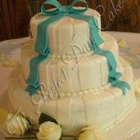 Melissa White Cake with Bavarian Cream filling. Fondant accents. They also had cookie favors to give out that I made. You can see them in my photo...