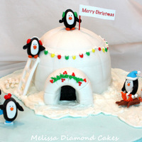 Penguins! Fondant covered cake igloo with fondant and royal accents. Thanks for looking and Merry Christmas! :0)