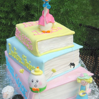 Mother Goose With Books Stacked book cake with a baby shower/Mother Goose theme! Humpty Dumpty, Little MIss Muffet, and Baa Baa Black Sheep are all in attendance :...