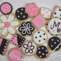 Cookies In Pink, Black, & White Sugar cookies with royal icing-yum!