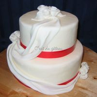 Red Sashes Dummy cake - 6-inch and 8-inch rounds with fondant sashes/roses.