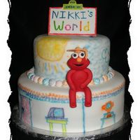 "Nikki's World This was for a graduation party. When the grad was a kid she loved Elmo. This is a 12"" and 8"" cake. Elmo is made out of gumpaste..."