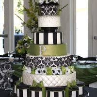 Green Black And White Damask Wedding Cake 7 Tiered cake with damask pattern on two tiers. Embellished with Swarovski rhinestone mongram and a few on the pillowed tier. Bows are...