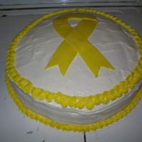 Yellow Ribbon Cake I had planned on covering this cake with MMF but I got distracted while I was melting the marshmellow in the microwave, and the MM exploded...