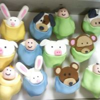 "Peek-A-Boo Cupcakes I did these for a baby shower. The baby's crib bedding are the ""Peek-A-Boo"" animals, so I thought it would be cute to do..."
