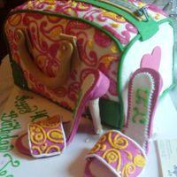 "Paisley Purse And Shoes Purse cake is two 12' X 12"" cakes cutin half then stacked on top of each other. Covered in fondant, buttercream detail. Shoes are..."
