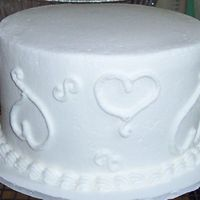Sample Wedding Cake 6 inch white with b/c icing. Sample cake I took to a bridezilla to drum up some business.