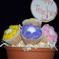 First Cupcake Bouquet  Inspired by Cammie's forum post on her cupcake bouquets. Made for My son's teacher. Son made the sign! White cupcakes w/bc icing...