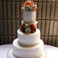 Terracotta Wedding Buttercream, gumpaste flowers and leaves and ribbon fillers.