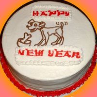 Year Of The Dog cake made in celebration for the Chinese new year. peanut butter cake with strawberry jam filling. the words are FBCT, I'm not...