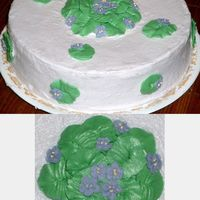 Violet Cake Brown sugar spice cake with violets I made for my grandmother. her favorite flowers are violets, and that shade is her favorite colour....