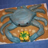 Chesapeake Bay Blue Crab Cake Crab and front claws are vanilla cake with cream cheese and sliced strawberry filling. The small legs are rice krispie treats. All covered...