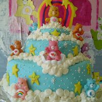 Care Bear Birthday Cake  This was for my daughter's 4th birthday. Chocolate cake with buttercream frosting. Stars and rainbow are fondant...my first time using...