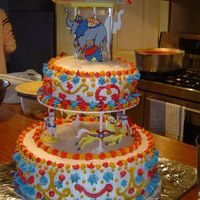 Amelia's Merry Go Round Cake  This was for my daughter's third birthday...it was a circus theme and she HAD to have a merry-go-round cake. All icing buttercream. I...