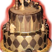 Chocolate And Gold Chess Cake   sort of a mad-hatter/whimsy theme. but i didnt want to do those slanted tiers. handmade the chess figures from gumpaste.