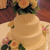 7/7/07 Wedding Cake   fondant pleats, cornelli lace, swiss dots with silver dragee accents, basketweave. fresh flowers