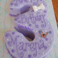 3Rd Birthday This is carved from 2 - 8 inch cakes and 2 - 9 inch cakes. Filled and then carved to achieve number 3 shape. Frosted in buttercream with...