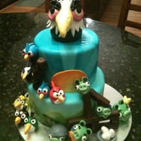 Angry Birds! Angry birds cake.. all fondant details, airbrushed tiers... with the Mighty Eagle atop!
