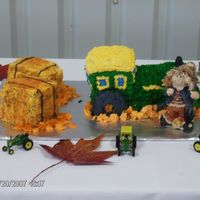 Tractor Grooms Cake For Doug Chocolate cake with buttercream icing and two hay stacks also with buttercream icing