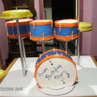 Drum Set Cakes This is a drum set. They are all chocolate cake, choc. buttercream, and fondant icing. It was a big hit.