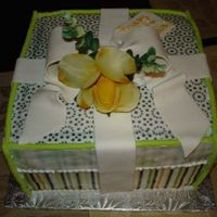 "Gift Box 8""sq buttercream with frosting sheets for the wrapping paper."