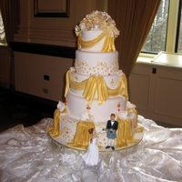 Fairmont Hotel Vancouver 5 tier wedding cake detailed and painted with edible gold.