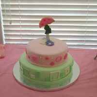 """mod Mom"" Baby Shower I got the idea for this cake on this site . . . of course! The top layer is chocolate with strawberry filling and the bottom is white with..."