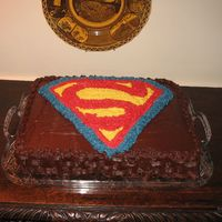 Superman Grooms Cake This is a grooms cake I did for a superman fan. He wanted to the superman symbol on it. It is a chocolate cake with cookies and cream...