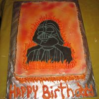Darth Vader Birthday Cake This is a free hand draw of darth vader ( I am not that good of an artist) white cake with buttercream icing and flames coming up from the...