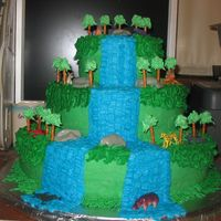Rain Forest Cake I did this for a local school for their cast party after their rainforest play. It is white cake with chocolate fudge filling and...
