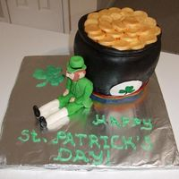 St. Patrick's Day Pot O' Gold Pot O' Gold cake with Leprechaun figure. Cake is french vanilla with a black cherry filling, made from half the sports ball pan and a...