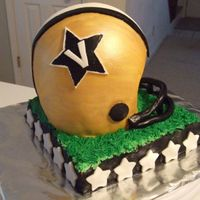 Vanderbilt Football Helmet Cake Helmet cake for my football fanatic husband! Vandy is my alma mater and his favorite college team. The helmt is orange cake with lemon-...