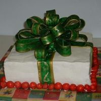 Christmas Package Cake My first mmf bow and first time with a square cake. The bow was fun, I'm anxious to try another one. Red velvet cake with cream cheese...