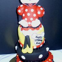 Minnie Mouse Topsy Turvy This cake is a Disney/Minnie Mouse themed topsy turvey cake. The minnie mouse was made in advance and is styrofoam covered in fondant. I...