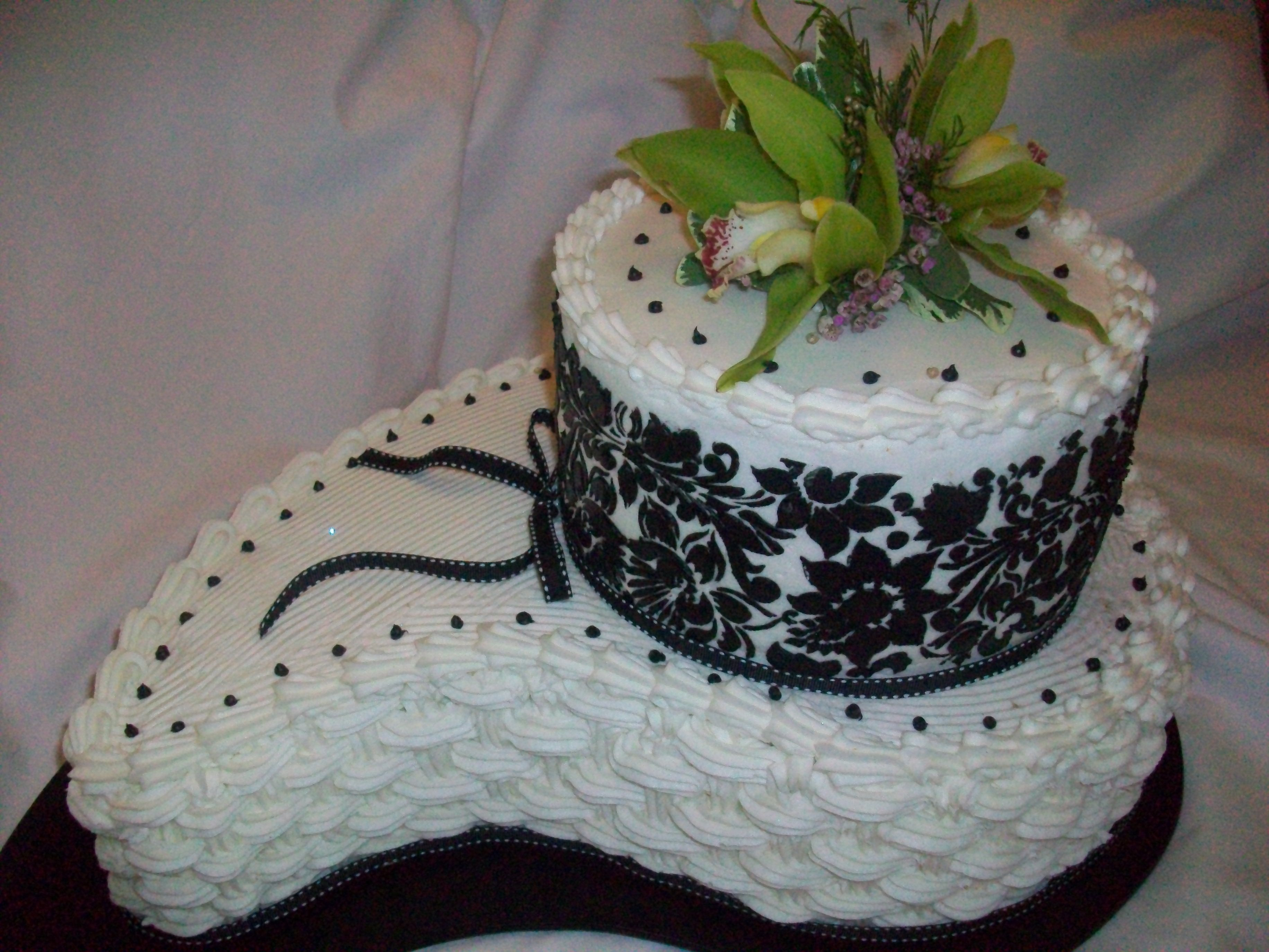 Black & White Cake I created this out of buttercream at the bride to be's request. This was for a bridal shower. I used a comma pan and a round cake for...