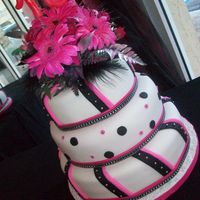Pink Black & Silver This is just a simple fondant cake with a color scheme of Pink, Black and Silver for a 16th birthday girl.