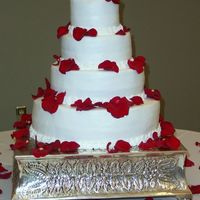 Simply Roses Stacked wedding cake with buttercream icing and rose petals. Simple, but elegant was this bride's theme.
