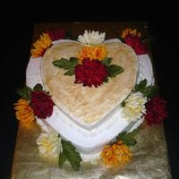 Heart Shaped Bridal Shower Cake  This was made for my cousin's bridal shower for an autumn wedding. White cakes with buttercream icing and gold dust. flowers are silk...