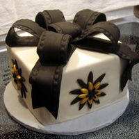 Wedding Cake Sample - Black & Gold This was a sample cake I created for a bride whose colors for her wedding are black and gold. The cake is a white cake with BC filling,...