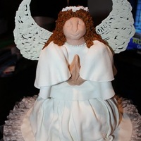 Angel Cake yellow cake with buttercream covered in marshmallow fondant. Wings are royal icing.