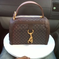 Louis Vutton Purse This was a cake made for my husbands Boss for her birthday. She had no clue that she was getting a cake not alone a purse cake. she was...