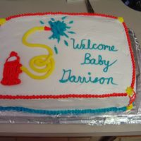 Fireman Baby Shower This is my first cake ever! Which explains why it's so wonky... LOL. One of these days I'll figure out how to make the sides even...
