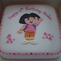 Dora The Explorer  The cake is a 10 inch chocolate madeira covered in chocolate butter cream and then fondant. Dora and all the decorations are fondant with...