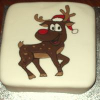 Rudolph The Red Nose Reindeer  This is my first attempt at flood icing with royal icing. I have learnt a few lesson about bubbles in the icing and the thickness of the...