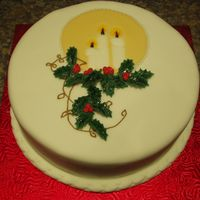 Christmas Candlelight This is an idea from a book called Making Beautiful Christmas Cakes. It is a fruit cake covered in mazipan and fondant. The candle plaque...