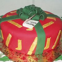 Christmas Present  This is an early cake for a Nursery (Kindergarten) Christmas fair. It is an 8 inch madeira cake covered in bc and then fondant. The ribbon...