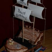 Ahoy Matey! First pirate ship. I reall yenjoyed this challenge! Fondant covered. Everything is edible but the sails. Added candles into the cannons.