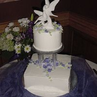 Olga And Dan Sweet cake for a small wedding. French vanilla cake with double coconut cream filling, BC icing, BC roses which are similar to elements of...