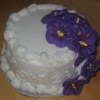 Tropical Wedding Test Cake This is a test cake for a bride who wanted a tropical theme. The flowers are fondant. The bride wanted purple hibiscus and she liked the...